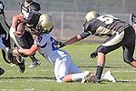 Palos Verdes, CA 09/24/10 - Logan Okuda (Peninsula #25) and Daniel Walker (Serra #20)  in action during the Serra-Peninsula varsity football game at Peninsula High School.