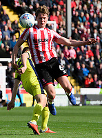 Lincoln City's Mark O'Hara vies for possession with Cheltenham Town's Jordan Tillson<br /> <br /> Photographer Chris Vaughan/CameraSport<br /> <br /> The EFL Sky Bet League Two - Lincoln City v Cheltenham Town - Saturday 13th April 2019 - Sincil Bank - Lincoln<br /> <br /> World Copyright © 2019 CameraSport. All rights reserved. 43 Linden Ave. Countesthorpe. Leicester. England. LE8 5PG - Tel: +44 (0) 116 277 4147 - admin@camerasport.com - www.camerasport.com
