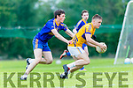 Darragh Roche, Glenflesk breaks away from Andy Fitzgerald, Spa during their Division 2 clash in Glenflesk on Saturday.