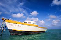 fishing boats anchored off fisherman's huts, Aruba, Netherlands Antilles
