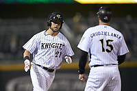 Matt Skole (21) of the Charlotte Knights rounds the bases after hitting his second home run of the game against the Rochester Red Wings at BB&T BallPark on May 14, 2019 in Charlotte, North Carolina. The Knights defeated the Red Wings 13-7. (Brian Westerholt/Four Seam Images)