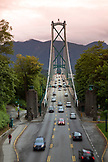 CANADA, Vancouver, British Columbia, cars and bikers travel across the first narrows of the Burrard Inlet over the Lions Gate Bridge
