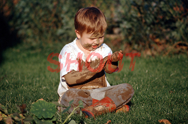 Little boy playing in the mud in his backgarden in summer. This image may only be used to portray the subject in a positive manner..©shoutpictures.com..john@shoutpictures.com