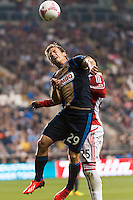 Antoine Hoppenot (29) of the Philadelphia Union goes up for a header with Jeremy Hall (25) of Toronto FC. The Philadelphia Union defeated Toronto FC 1-0 during a Major League Soccer (MLS) match at PPL Park in Chester, PA, on October 5, 2013.