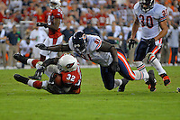 Oct. 16, 2006; Glendale, AZ, USA; Arizona Cardinals running back (32) Edgerrin James is tackled by Chicago Bears defensive tackle (91) Tommie Harris at University of Phoenix Stadium in Glendale, AZ. Mandatory Credit: Mark J. Rebilas