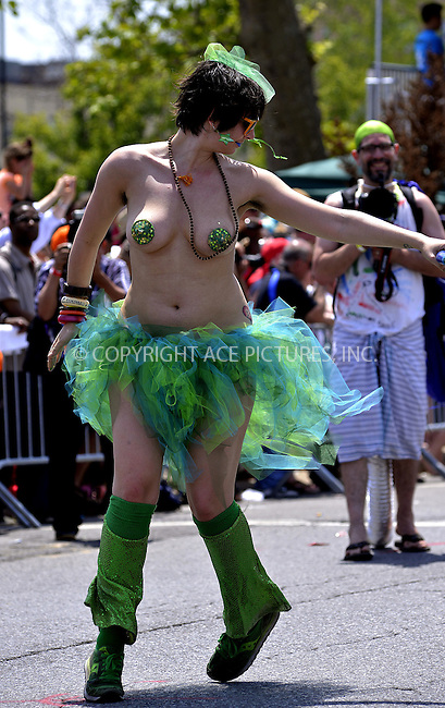 WWW.ACEPIXS.COM<br /> <br /> June 22 2013, New York City<br /> <br /> A parade participant at the 2013 Mermaid Parade at Coney Island on June 22, 2013 in New York City.<br /> <br /> By Line: Curtis Means/ACE Pictures<br /> <br /> <br /> ACE Pictures, Inc.<br /> tel: 646 769 0430<br /> Email: info@acepixs.com<br /> www.acepixs.com