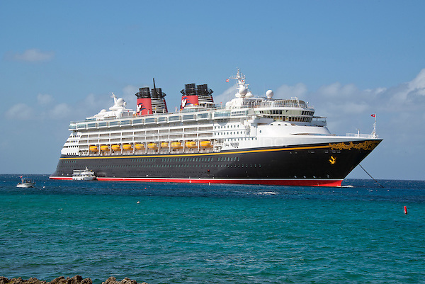 The Disney Wonder is a cruise ship operated by Disney Cruise Line, which carries 2,400 passengers and 945 crew, in the harbor of George Town, Grand Cayman in the Cayman Islands on Tuesday, December 20, 2016.  The smaller boats are tenders to ferry passengers back and forth to the island.<br /> Credit: Ron Sachs / CNP /MediaPunch
