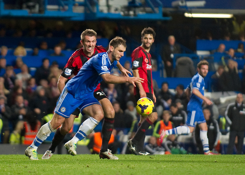 Chelsea's Branislav Ivanovic races back to the halfway line with the ball for a quick restart after Eden Hazard's late penalty<br /> <br /> Photo by Ashley Western/CameraSport<br /> <br /> Football - Barclays Premiership - Chelsea v West Bromwich Albion - Saturday 9th November 2013 - Stamford Bridge - London<br /> <br /> &copy; CameraSport - 43 Linden Ave. Countesthorpe. Leicester. England. LE8 5PG - Tel: +44 (0) 116 277 4147 - admin@camerasport.com - www.camerasport.com