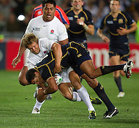 Rugby World Cup Auckland England v Scotland  Pool B 01/10/2011.Johnny Wilkinson  (England) tackles Jo Ansbro  (Scotland).Photo  Frey Fotosports International/AMN Images
