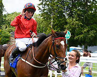 Pow Wow ridden by Kieran Shoemark is led into the winners enclosure after winning The Derek Burridge Golf & Racing Trophies Handicap during Father's Day Racing at Salisbury Racecourse on 18th June 2017
