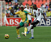 South Africa's Sibusiso Zuma and USA's DaMarcus Beasley during first half action between the national teams of South Africa (RSA) and the United States (USA) in an international friendly dubbed the Nelson Mandela Challenge at Ellis Park Stadium in Johannesburg, South Africa on November 17, 2007.