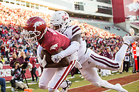 NWA Democrat-Gazette/BEN GOFF @NWABENGOFF<br /> Mike Woods, Arkansas wide receiver, hauls in a catch in the end zone to score in front of Fred Peters, Mississippi State star, in the third quarter Saturday, Nov. 2, 2019, at Reynolds Razorback Stadium in Fayetteville.