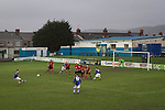 Second-half action as Port Talbot Town (in blue) play host to Caerau Ely in a Welsh Cup fourth round tie at the Genquip Stadium, formerly known as Victoria Road. Formed by exiled Scots in 1901 as Port Talbot Athletic, they competed in local and regional football before being promoted to the League of Wales  in 2000 and changing their name to the current version a year later. Town won this tie 3-0 against their opponents from the Welsh League, one level below the welsh Premier League where Port Talbot competed, watched by a crowd of 113.