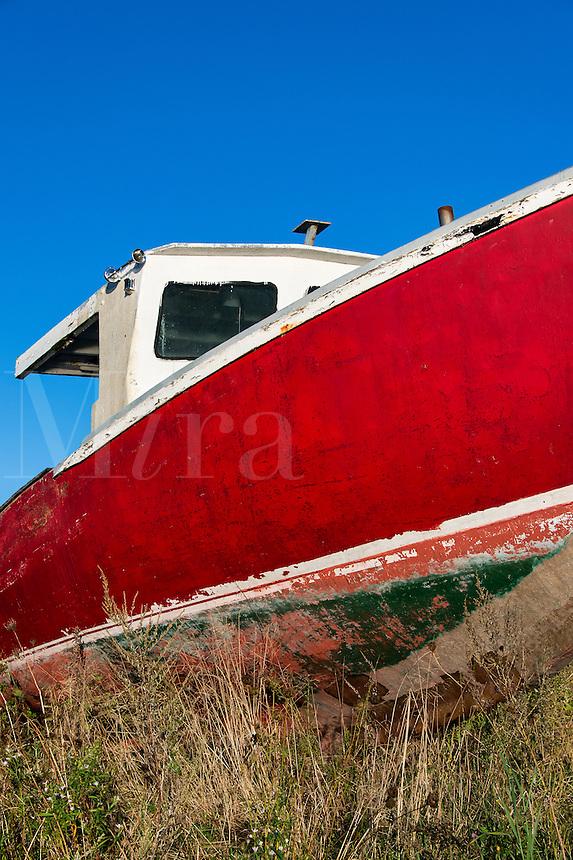 Old weathered drydocked boat.