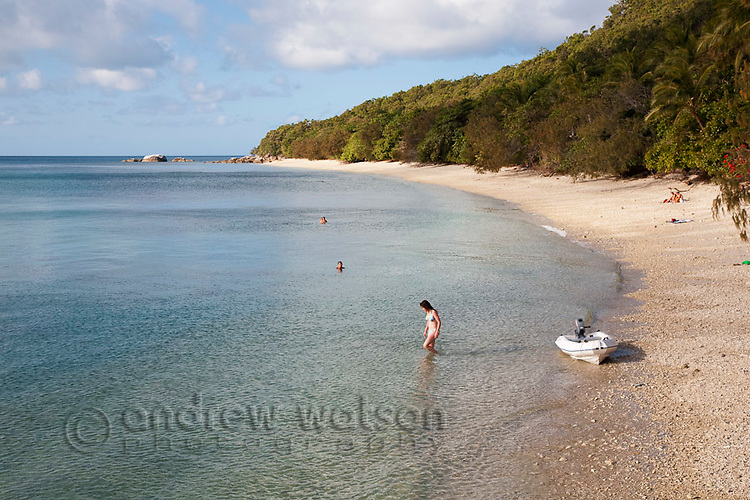 Woman swimming in Welcome Bay.  Fitzroy Island National Park, Cairns, Queensland, Austtralia