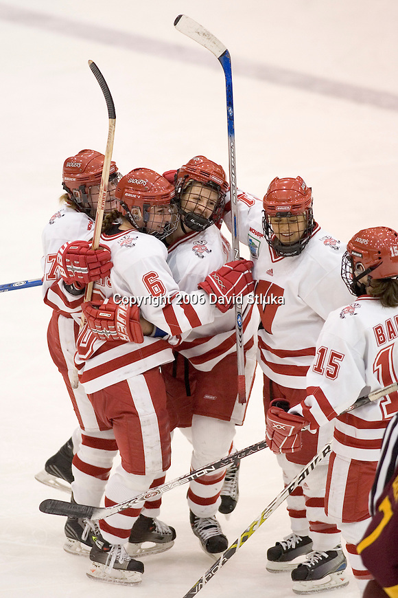 MINNEAPOLIS, MN - MARCH 26: Teammates Cyndy Kenyon #21, Sara Bauer #15, Kristen Witting #17 and Emily Morris #6 of the Wisconsin Badgers celebrate Jinelle Zaugg #8  2nd goal against the Minnesota Golden Gophers at Mariucci Arena during the Women's Frozen Four Tournament final on March 26, 2006 in Minneapolis, Minnesota. The Badgers beat the Gophers 3-0. (Photo by David Stluka)