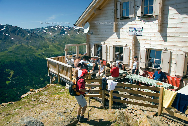 Soelden, Oetztal, Tyrol, Austria, August 2009. Hikers enjoy the panoramic views, on the Wannekarsattel trail from Timmelsjoch to the Brunnenkoglhaus hut. A valley full of opposites, between action and relaxation. Lush green meadows and mighty rocks. White waters and eternal ice. Photo by Frits Meyst/Adventure4ever.com