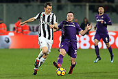 9th February 2018, Stadio Artemio Franchi, Florence, Italy; Serie A football, ACF Fiorentina versus Juventus; (L-R) Stephan Lichtsteiner of Juventus is tackled by Jordan Veretout of Fiorentina