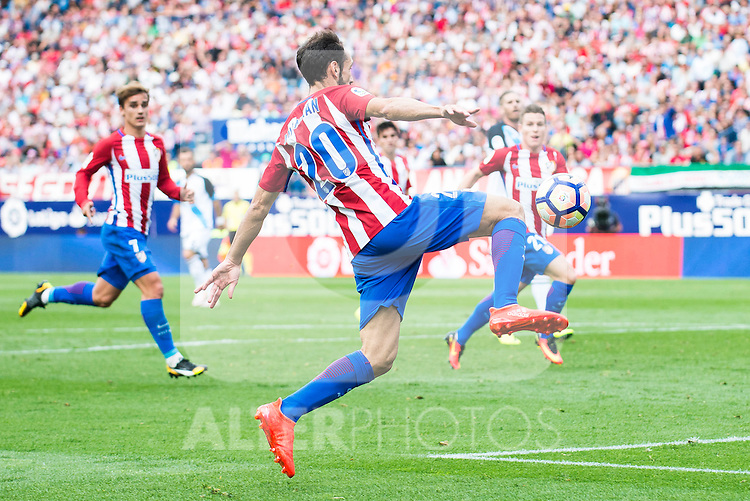 Atletico de Madrid's players Juanfran Torres, Antoine Griezmann and Kevin Gameiro during a match of La Liga Santander at Vicente Calderon Stadium in Madrid. September 25, Spain. 2016. (ALTERPHOTOS/BorjaB.Hojas)