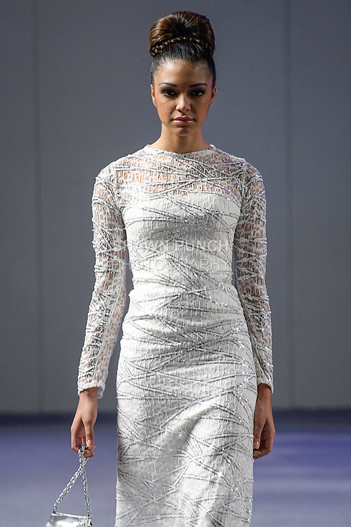 Model walks runway in an outfit from the Marisol Henriquez collection, during Couture Fashion Week New York Spring 2013, on September 17, 2012.
