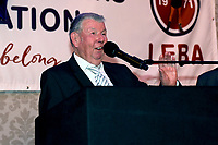 Ken Selleck (R) speaks after receiving the Reg Gutteridge award for Services to Boxing Media during the London Ex-Boxers Association Awards Lunch at the Grand Connaught Rooms on 16th February 2020