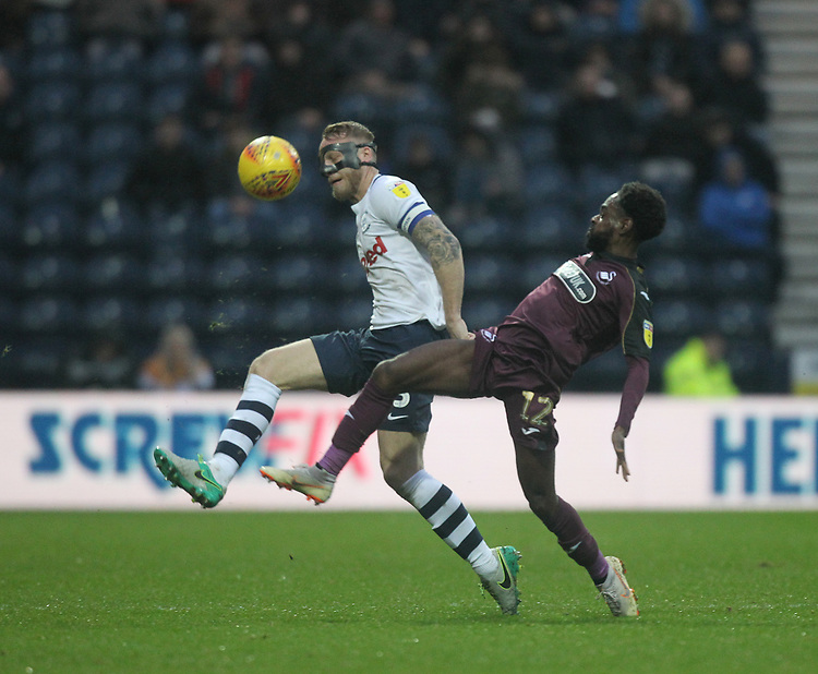 Preston North End's Tom Clarke in action with Swansea City's Nathan Dyer<br /> <br /> Photographer Mick Walker/CameraSport<br /> <br /> The EFL Sky Bet Championship - Preston North End v Swansea City - Saturday 12th January 2019 - Deepdale Stadium - Preston<br /> <br /> World Copyright &copy; 2019 CameraSport. All rights reserved. 43 Linden Ave. Countesthorpe. Leicester. England. LE8 5PG - Tel: +44 (0) 116 277 4147 - admin@camerasport.com - www.camerasport.com