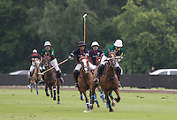 Joaquin Pittaluga (Salkeld) and Marcos Di Paola (King Power) head towards the ball during the Cartier Queens Cup Final match between King Power Foxes and Dubai Polo Team at the Guards Polo Club, Smith's Lawn, Windsor, England on 14 June 2015. Photo by Andy Rowland.