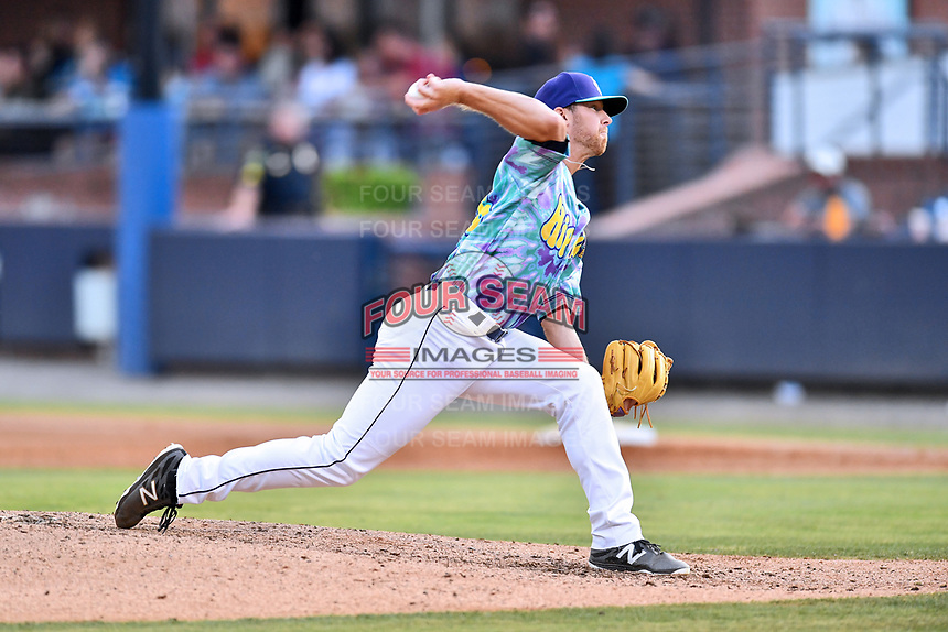 Asheville Hippies pitcher Jared Gesell (16) delivers a pitch during a game against the Greenville Drive at McCormick Field on June 29, 2017 in Asheville, North Carolina. The Drive defeated the Tourists 9-6. (Tony Farlow/Four Seam Images)