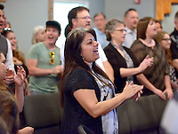 NWA Democrat-Gazette/BEN GOFF -- 04/19/15 Valerie Wilcoxson of Rogers takes part in the service during 'Charter Day' at The Neighborhood Church, a contemporary Lutheran church in Bentonville, on Sunday Apr. 19, 2015.