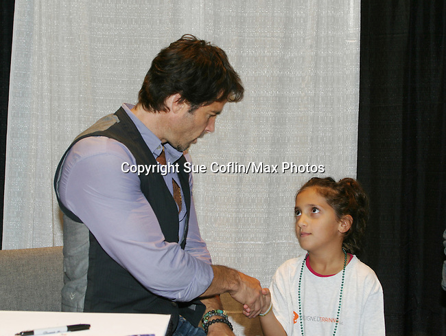 """Fans pose with Days Our Lives Shawn Christian """"Daniel"""" who highlights the 10th Annual Connecticut Women's Expo on September 23, 2012 in Hartford, Connecticut and also on Sunday Sept 24 where he signed for fans and posed for photos.  (Photo by Sue Coflin/Max Photos)"""