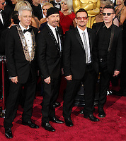 HOLLYWOOD, LOS ANGELES, CA, USA - MARCH 02: Adam Clayton, The Edge, Bono and Larry Mullen Jr of U2 at the 86th Annual Academy Awards held at Dolby Theatre on March 2, 2014 in Hollywood, Los Angeles, California, United States. (Photo by Xavier Collin/Celebrity Monitor)