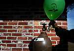 Evan Gilbert, 16 from DeLand, blows up balloons Saturday, January 18, 2003 during the Electralyte Charity Club Annual Martin Luther King Jr. Dreamfest in Earl Brown Park in DeLand. (Chad Pilster)
