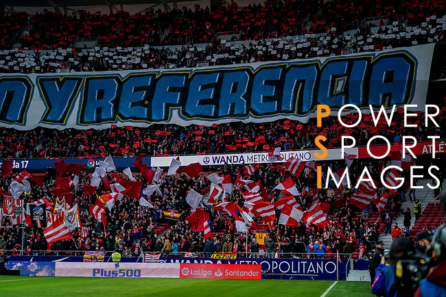 Soccer fans of Atletico de Madrid waves flags and banners to show supports to their team during the La Liga 2018-19 match between Atletico de Madrid and RCD Espanyol at Wanda Metropolitano on December 22 2018 in Madrid, Spain. Photo by Diego Souto / Power Sport Images