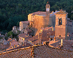 Tuscany, Italy:  Bell towers above the terraced buildings and tiled roofs of Sorano, a hill town in southern Tuscany
