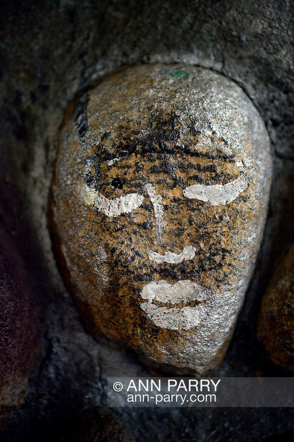 Stone with face grafitti, part of inner wall of gazebo at Heckscher Park, on November 8, 2014, at Huntington, Long Island, New York, USA