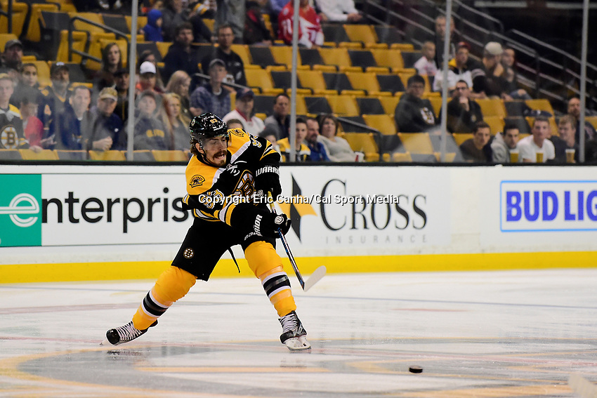 Wednesday, September 28, 2016: Boston Bruins right wing Peter Mueller (93) shots the puck during the NHL game between the Detroit Red Wings and the Boston Bruins held at TD Garden, in Boston, Massachusetts. Detroit beats Boston 5-1 in regulation time. Eric Canha/CSM