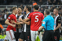 Scott McTominay of Man Utd involved in heated exchange with Andy Carroll of Newcastle United at full time during the Premier League match between Newcastle United and Manchester United at St. James's Park, Newcastle, England on 6 October 2019. Photo by J GILL / PRiME Media Images.