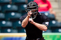 Home Plate Umpire Ian Fazio calls a strike during a game between the Arkansas Travelers and the Springfield Cardinals at Hammons Field on May 8, 2012 in Springfield, Missouri. (David Welker/ Four Seam Images)