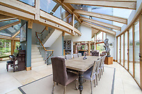 BNPS.co.uk (01202 558833)<br /> Pic: Savills/BNPS<br /> <br /> A futuristic eco-home in the heart of the English countryside has emerged for sale for a whopping £3.5m.<br /> <br /> Coachman's Lodge, near Farnham in Surrey, was built just 11 years ago and looks like something straight out of TV's Grand Designs.<br /> <br /> It has a striking wooden frame, enormous floor to ceiling windows and an environmentally friendly grass roof to help it blend in to its idyllic and secluded location.<br /> <br /> The 5,000sq ft building has a stylish wooden frame and enormous eco-friendly glass windows that allow for spectacular country views.