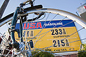 An USA Gasoline price list viewed through a bicycle wheel on March 24, 2009. Los Altos, California, USA