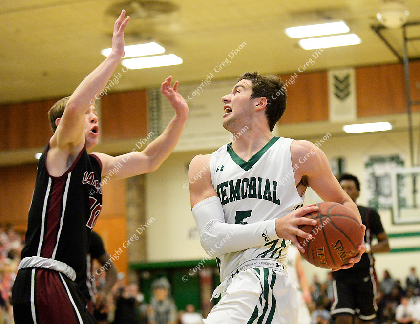 Memorial's Jake Ferguson tries to get by Middleton's Storm Murphy in the Big Eight Conference boys basketball game between Middleton and Madison Memorial on Thursday at Memorial High School in Madison