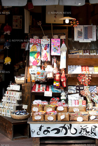"February 14, 2013, Kawagoe, Japan - Traditional Japanese sweets and toys  at ""Little Edo"", Kawagoe. An old town from Edo Period (1603-1867) is located in Kawagoe, 30 minutes by train from central Tokyo. In the past Kawagoe was an important city for trade and strategic purpose, the shogun installed some of their most important loyal men as lords of Kawagoe Castle. Every year ""Kawagoe Festival"" is held in the third weekend of October, people pull portable shrine during the parade, later ""dashi"" floats on the streets nearby. The festival started 360 years ago supported by Nobutsuna Matsudaira, lord of Kawagoe Castle. (Photo by Rodrigo Reyes Marin/AFLO).."