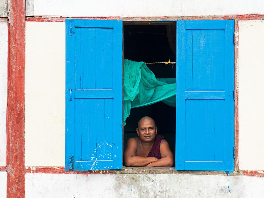 Buddhist Monk at the Monastery Window, Rakhine State, Myanmar