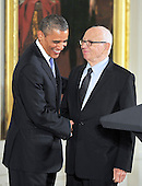 Ellsworth Kelly, right, shakes hands with United States President Barack Obama, left, prior to accepting the 2012 National Medal of Arts during the presentation ceremony in the East Room of the White House in Washington, D.C. on Wednesday, July 10, 2013.<br /> Credit: Ron Sachs / CNP