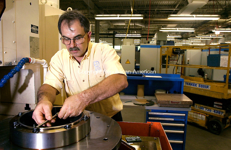 NEW HARTFORD, CT - 12 JULY 2005 -071205JS04--Steve Audia, gear department forman at Perry Technology Corp. in New Hartford works on a 20-4 CNC machine. The machine is a gear shaper that cuts spline teeth in gears. The company makes a component for a torsion hinge assembly used on the 17-inch disconnect valve for the external few tanks on the space shuttle  --Jim Shannon Photo--Perry Technology Corp.; New Hartford, Steve Audia are CQ