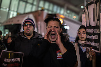 NEW YORK, NY - JANUARY 28: A man attend to a demonstration against the Muslim immigration ban at John F. Kennedy International Airport on January 28, 2017 in New York City. President Trump signed an executive order to suspend refugee arrivals and people with valid visa from Iran, Iraq, Libya, Somalia, Sudan, Syria and Yemen. Photo by VIEWpress/Maite H. Mateo.