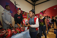 NWA Media/DAVID GOTTSCHALK - 12/12/14 -  Athletes Nick Babb and Michael Qualls Friday December 12, 2014 at the Donald W. Reynolds Boys and Girls Club in Fayetteville. Members of the basketball team and staff represented the University of Arkansas Student Athletes as they partnered with the Dwelling Place and the Donald W. Reynolds Boys and Girls Club in distributing 99 hams to children and families at the club.