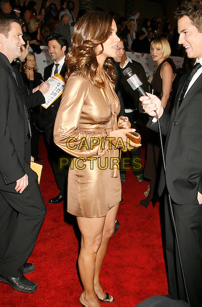 HALLE BERRY.The 33rd Annual People's Choice Awards held at The Shrine Auditorium, Los Angeles, California, USA..January 9th, 2007.full length gold metallic dress interview profile microphone.CAP/ADM/RE.©Russ Elliot/AdMedia/Capital Pictures