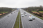 Traffic driving in winter on the M5 motorway near Bridgwater, Somerset, England looking south