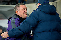 Swansea u21's Manager Garry Richards shakes hands with Manager of Coventry Russell Slade  during the EFL Checkatrade Trophy Quarterfinal Match between Swansea City U21 and Coventry City at the Liberty Stadium, Swansea on January 24, 2017